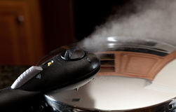 Steam escaping from new pressure cooker pot Stock Photography