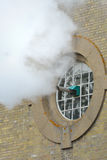 Steam exiting building Stock Photos