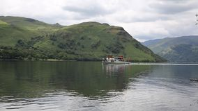 Steam ferry with holidaymakers and tourists Ullswater Lake District Cumbria England UK stock video footage