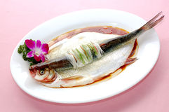 Steam fish. A delicious steamed fish on a plate stock photo