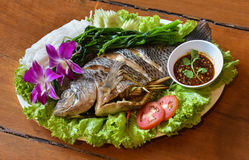 Steam fish. Fresh vegetables steam with sauce spicy Royalty Free Stock Photography