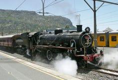 Steam at Fish Hoek. Atlantic rail steam locomotive at Fish Hoek station Stock Photo