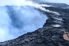 Steam, gases and sulfuric acid rise from Kilauea caldera. Hawaii royalty free stock photo