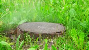 Steam from hatchway sump sewage system stock footage