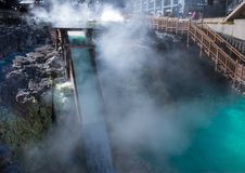 Steam of hot spring. Yubatake hot spring is landmark in Kusatsu onsen. Gunma,Japan Royalty Free Stock Photography