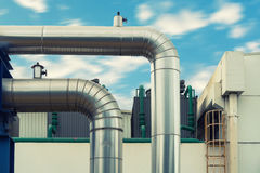 Steam insulation pipeline at corner., Steam pipe insulation. Royalty Free Stock Images