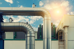 Steam insulation pipeline at corner with sunshine. Royalty Free Stock Photography