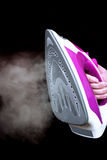 Steam Iron. Steaming electric iron held in hand, isolated Royalty Free Stock Images