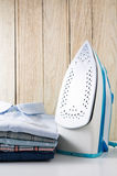 Steam iron and shirts Stock Photos