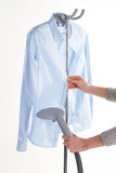 Steam iron to make housewife clothing works more easy. Stock Image