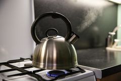 Steam from the kettle through the whistle. royalty free stock images