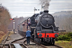 Steam loco and token Stock Images