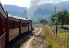 Steam locomotive. An old steam engine emitting smoke steam and dirt in a rural scene in Tiradentes, Brazil Stock Images