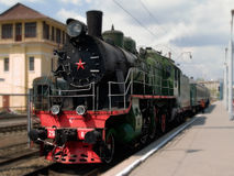 Steam locomotive. On platform of station. This  is made in the middle of 20 centuries, but continues to transport passengers Royalty Free Stock Image
