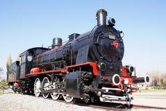 Steam locomotive. A monument near railway station Kaisery Stock Photos