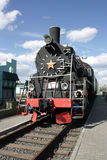 Steam locomotive. The photo of an old Russian steam locomotive is made at station in the city of Omsk, Russia Royalty Free Stock Image
