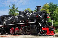Steam locomotive. A steam locomotive with red wheel in sunny day stock images