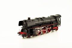 Steam locomotive. Black toy locomotive isolated on white background Royalty Free Stock Images