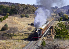 Steam locomotive 3016 travelling through countrysi. Restored steam locomotive 3016 steams from Canberra to Bungendore through the Molonglo Gorge with two Stock Photo