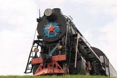 Steam locomotive. Old restored steam locomotive on a pedestal Stock Image