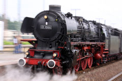 Steam locomotive. Old steam train locomotive in motion royalty free stock images