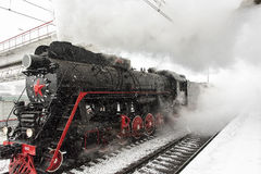 Steam Locomotive accelerates Royalty Free Stock Images