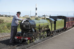 Steam locomotive being polished Dunegess Station UK Royalty Free Stock Image