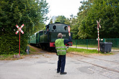 Steam locomotive and belgian railcar on display at Treignes, Belgium Royalty Free Stock Image