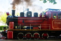 Steam locomotive blowing off the smoke Stock Photography