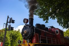 Steam locomotive blowing off the smoke Royalty Free Stock Photos