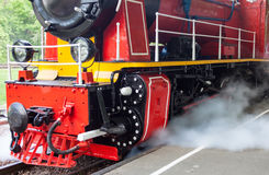 Steam locomotive blowing off the steam stock images