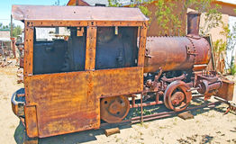 Steam Locomotive. Built on site using some parts purchased from a manufacturer, this five ton steam locomotive was used to pull ore cars in the Yellow Aster Mine Stock Photo