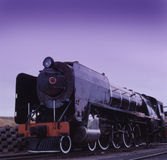 Steam locomotive at dawn Royalty Free Stock Photo