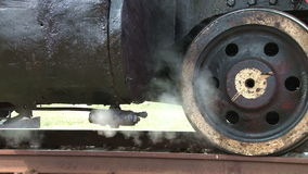 Steam locomotive detail as engine departs. Close up detail of small steam pipe stock video