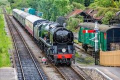Steam locomotive Eddystone pulling into Corfe Castle station taken in Corfe Castle, Dorset, UK royalty free stock photo