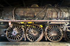 Old rusty steam locomotive. Steam locomotive in the engine house Stock Image