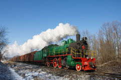 Steam locomotive with freight cars. Royalty Free Stock Images