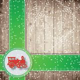 Steam locomotive, green tapes and snowflakes on the wooden board background. Royalty Free Stock Image