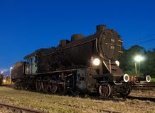 Steam locomotive with junk. Royalty Free Stock Image
