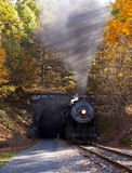 Steam locomotive leaving tunnel Royalty Free Stock Image