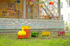 Steam locomotive made of plastic boxes and bottles on lawn on playground.  royalty free stock images