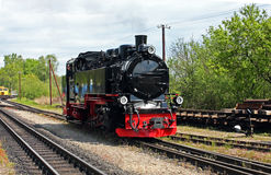 Steam Locomotive. Narrow Gauge Steam Locomotive moving in station Stock Images