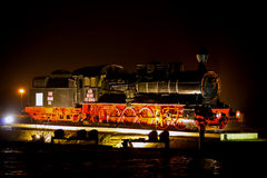 Steam locomotive at night Stock Images
