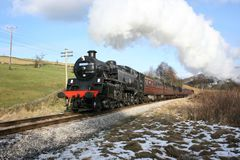 Steam locomotive 80002 at Oakworth Bank on the Keighley and Wort. H Valley Railway, West Yorkshire, UK - February 2009 Stock Photo
