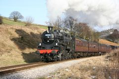 Steam locomotive 80002 at Oakworth Bank on the Keighley and Wort. H Valley Railway, West Yorkshire, UK - February 2009 Stock Image