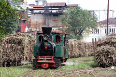 Steam locomotive. Old steam locomotive made ??in germany Tasikmadu owned sugar mills, Karanganyar, Central Java, Indonesia is still actively used to draw a Royalty Free Stock Image