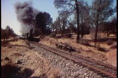 Steam locomotive passing through countryside stock video