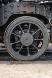 Steam Locomotive Pilot Truck Wheel. 19th century steam locomotive pilot truck wheel. Medium close-up Royalty Free Stock Images