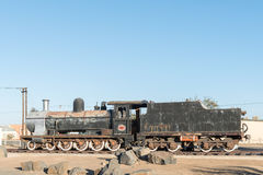 Steam locomotive at the railway station in Keetmanshoop. KEETMANSHOOP, NAMIBIA - JUNE 13, 2017: An historic class 7A no.1011 steam locomotive at the railway Stock Image