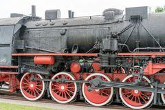 Steam locomotive with red wheels. Retro locomotive on rails. stock photos
